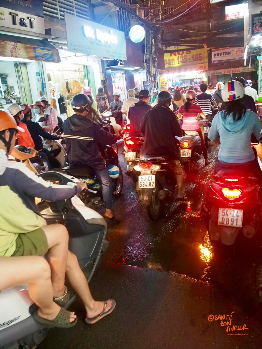 Early evening motorbikes on a street in District 4, Ho Chi Minh City (Saigon), Vietnam, 2017