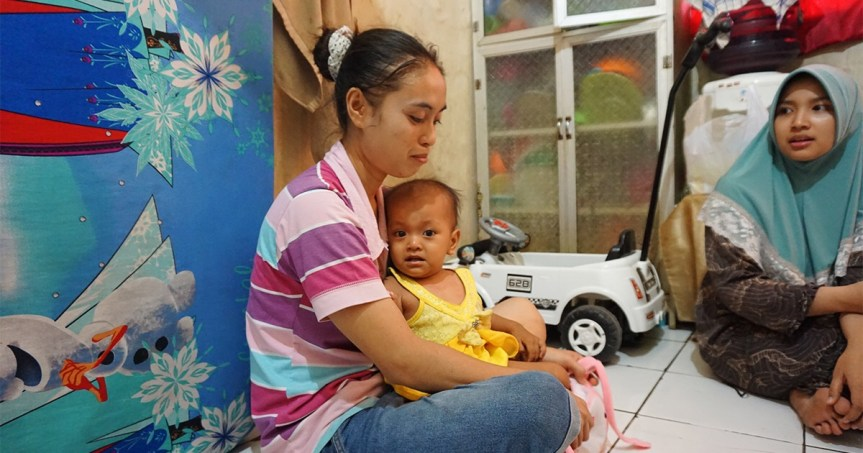 Umi, a Mother in North Jakarta, Indonesia, With Her Daughter