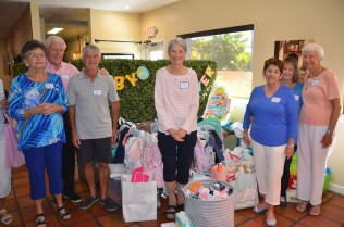 Dottie McGovern, left, Gerry Risch, Andrew Jacob, Suzie Cullen, Judy Risch, Sandra Dalbec and Karen Sartoris with baby items collected for the Guadalupe Social Services.