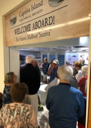 Attendees see the makeover of the Old Santiva Mailboat History Gallery at the Captiva Library