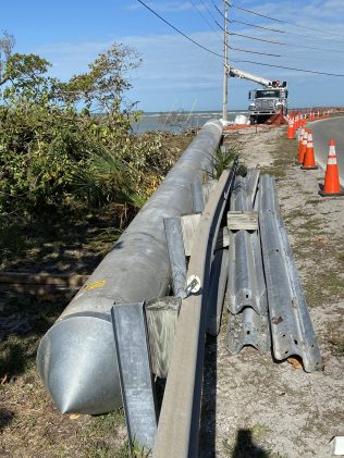 The replacement LCEC utility pole lies safely behind the guardrail along Sanibel Captiva Road, near Blind Pass. SC photo by Associate Publisher Chuck Larsen
