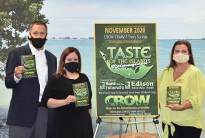 Bank of the Islands' David Lowden and Willy Ocasio with CROW executive director Alison Charney Hussey
