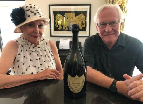 """Platinum sponsors Joyce and Don Rice with the magnum of 2008 Dom Perignon that will be part of the special """"50/50 + 10"""" drawing"""