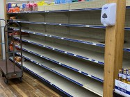 Grocery store shelves become bare as residents begin quarantining