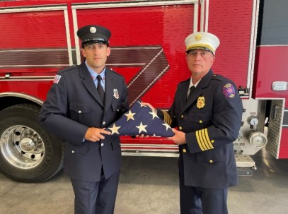 Members of the Captiva Fire Department ceremoniously fold the historic flag.