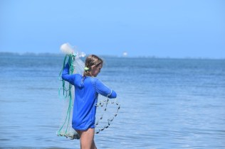 A student is using a seine net