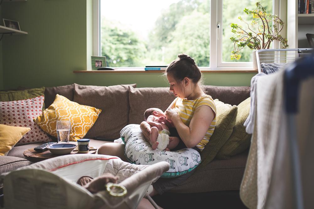 newborn photography baby breastfeeding