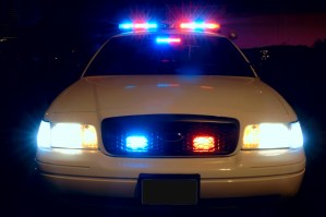 Long exposure to capture the full array of police car lights. 12MP camera.