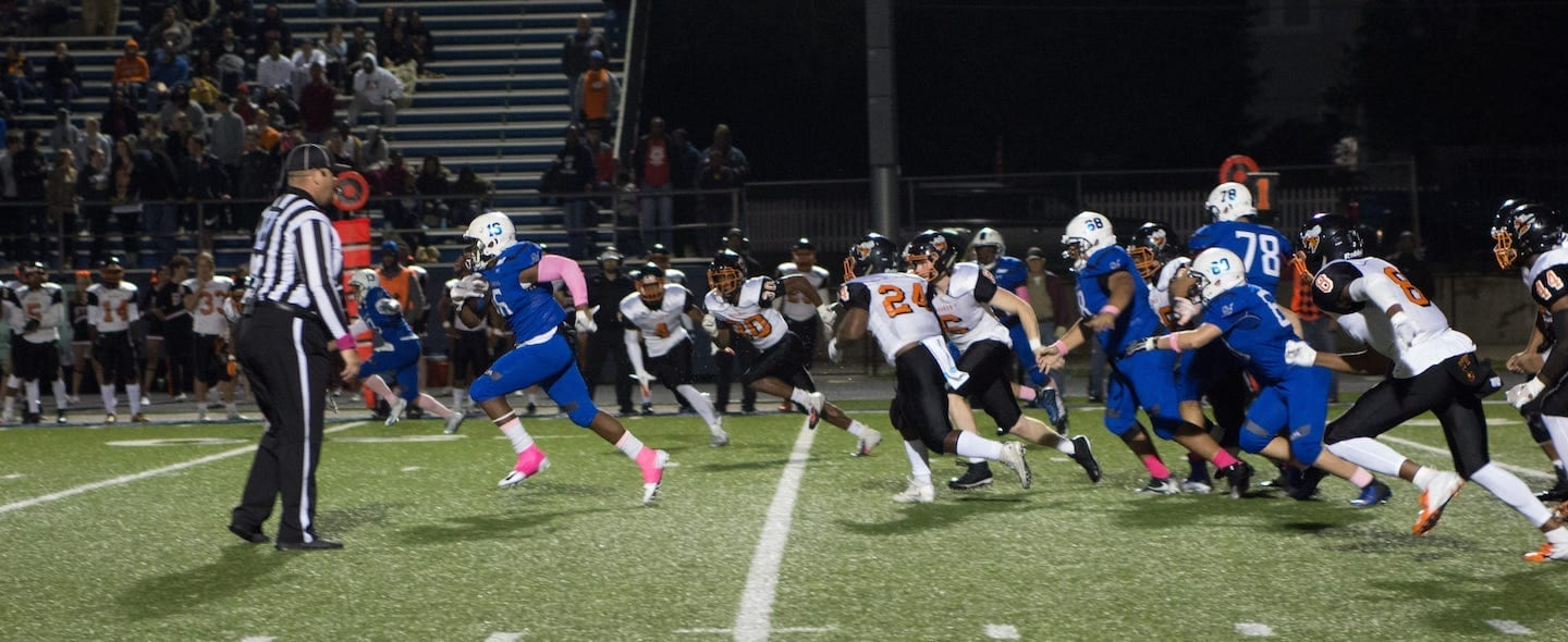 Senior A.J. Checotah delivers a 52-yard run before bring brought down in Sapulpa's game against Booker T. Hornets. Photo by Kristi Howard