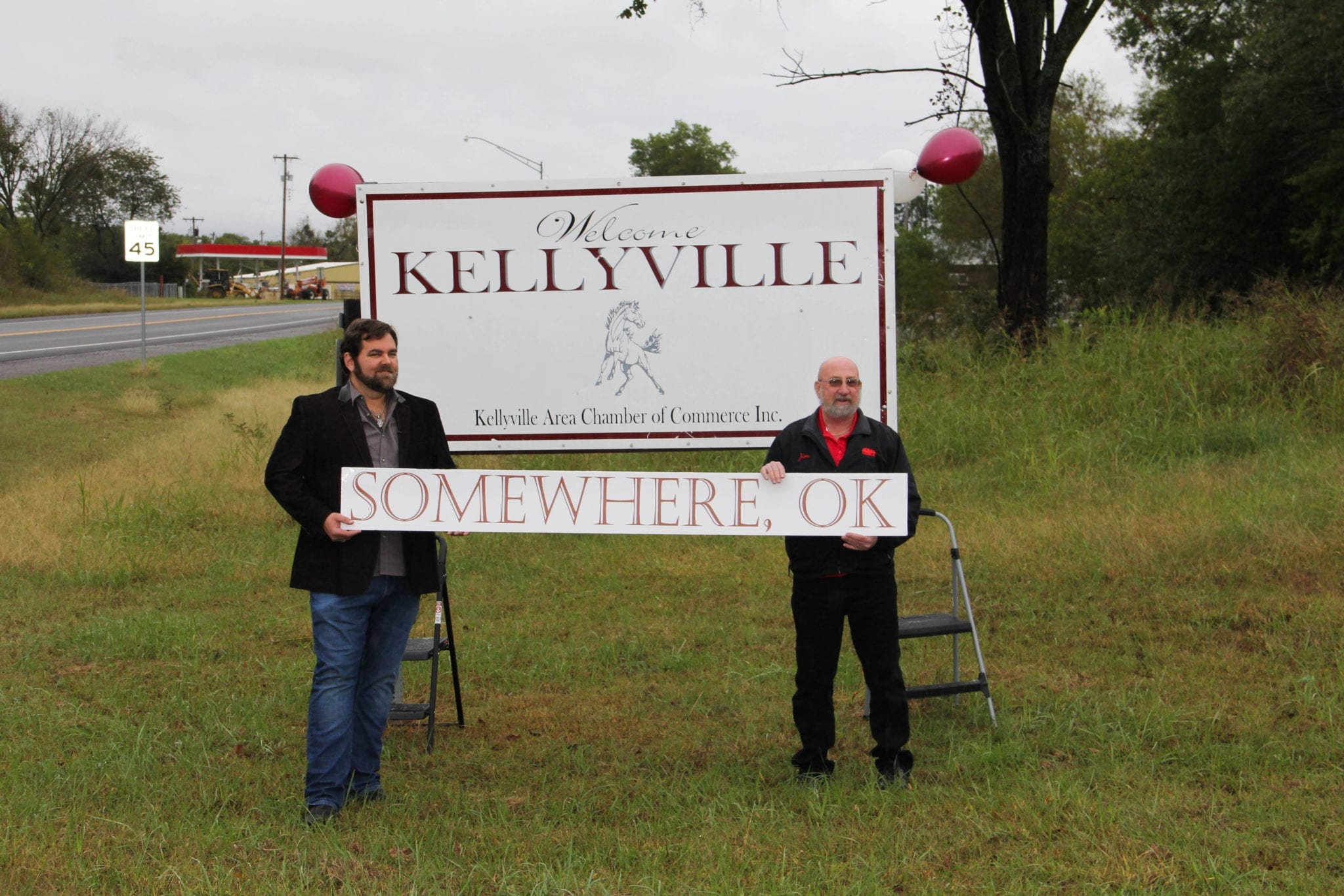 "James Robert Webb (left) and Mayor Jim Vogt change the name of Kellyville to Somewhere to celebrate James' new single ""Now We're Gettin' Somewhere"""