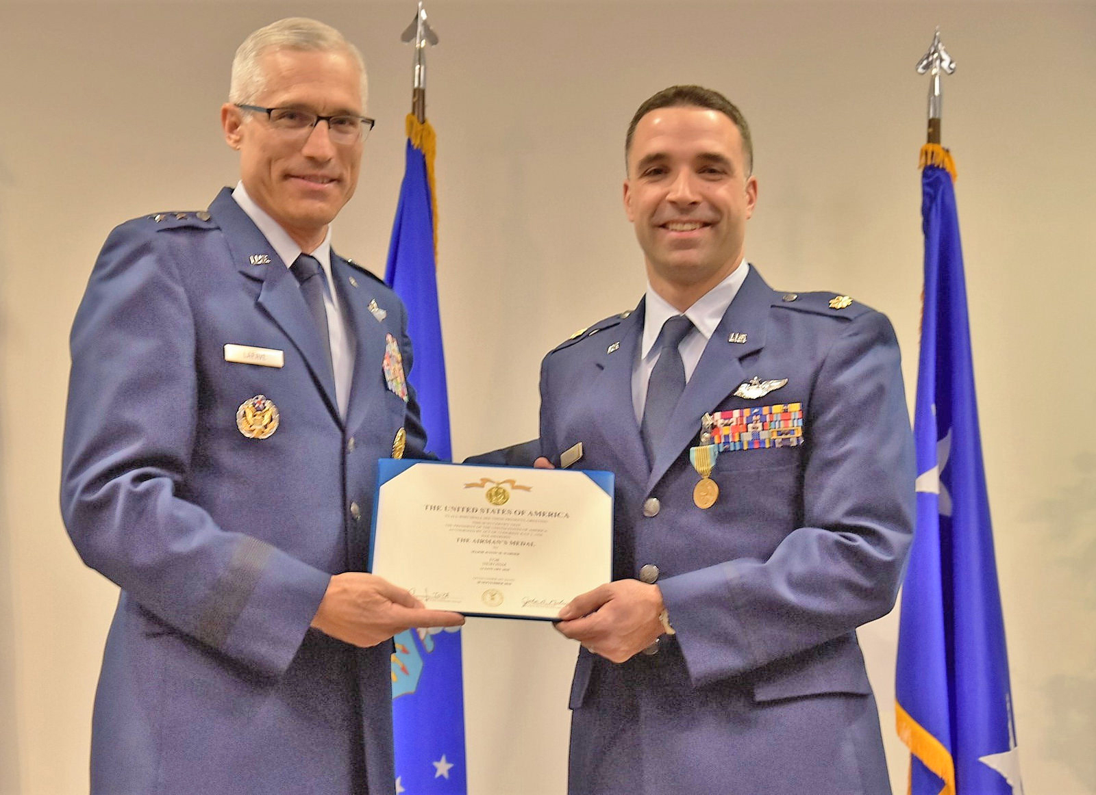 Major Justin Warner, right, receives the Airman's Medal for an extraordinary act of bravery outside of combat. Photo by Shepphard Air Force Base
