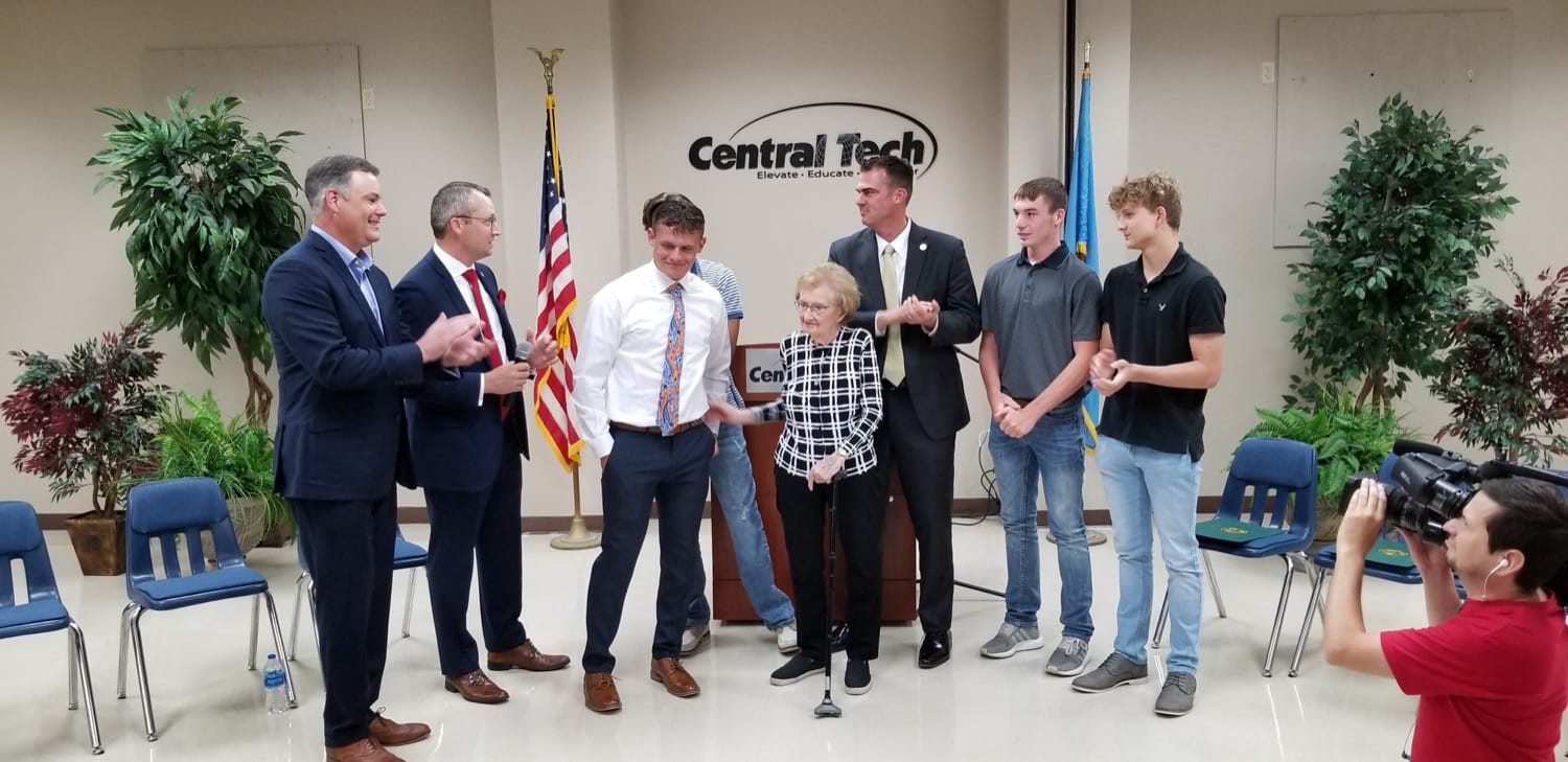 Left to Right: Senator James Leewright, Representative Mark Lawson, Wyatt Hall, Catherine Ritchie, Governor Kevin Stitt, Dylan Wick, Nick Byrd (Seth Byrd is behind Hall). Photo by Charles Betzler.
