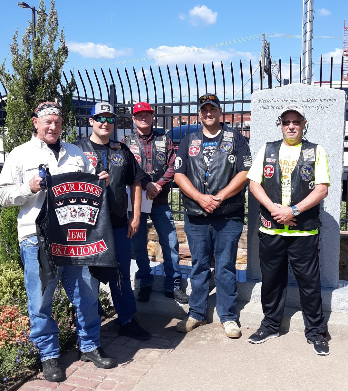Four Kings LE/MC members Jim Holcomb, Officer Tyler Stroup, Lt. Jim Madden, Gary McFarland and Kedrick Bowling.