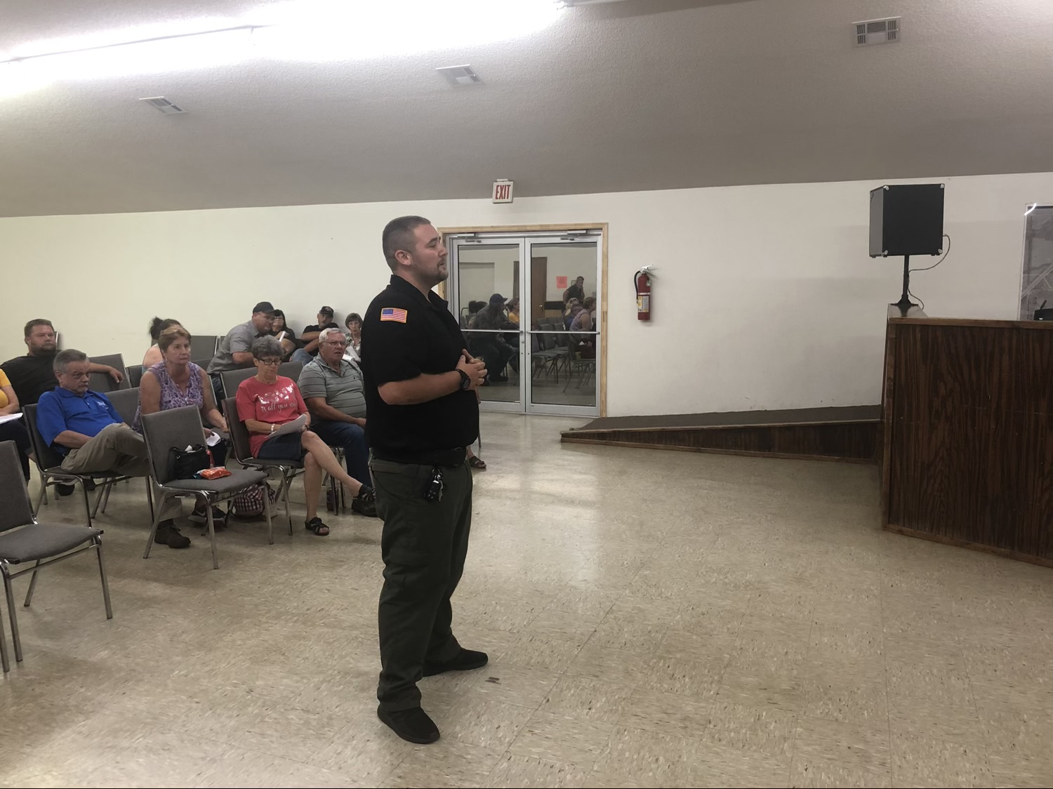 Officer Tyler Stroup stands at the Kellyville Board meeting and gives his two weeks' notice after hearing the board's decision not to promote Chief Davis.