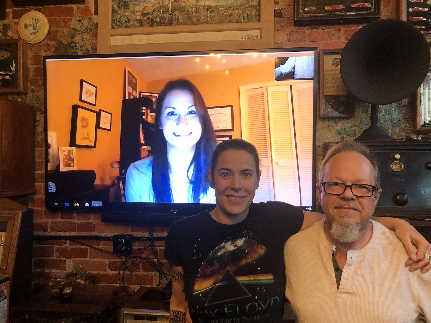 Leah Cole (in the monitor), Lindsay Allison, Jim McGee post during a video conference at Signs of the Times.