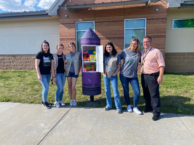 Girl Scouts brighten two elementary schools with free school supplies boxes