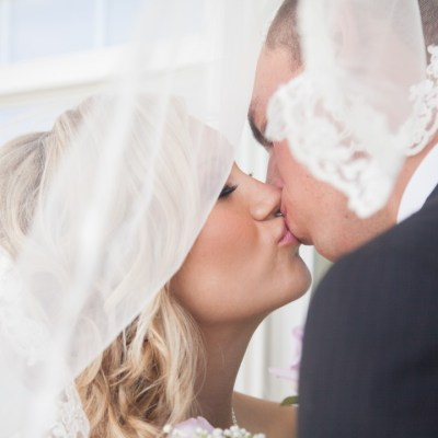 Naperville wedding, bride and groom share a kiss under the veil | Rockford, Illinois Wedding Photographer Sara Anne Johnson