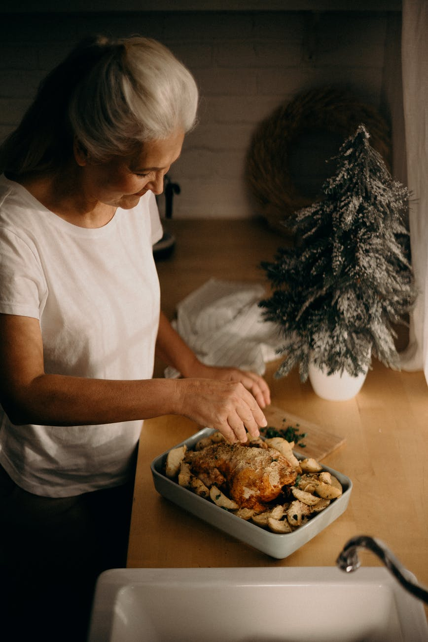 woman cooking chicken