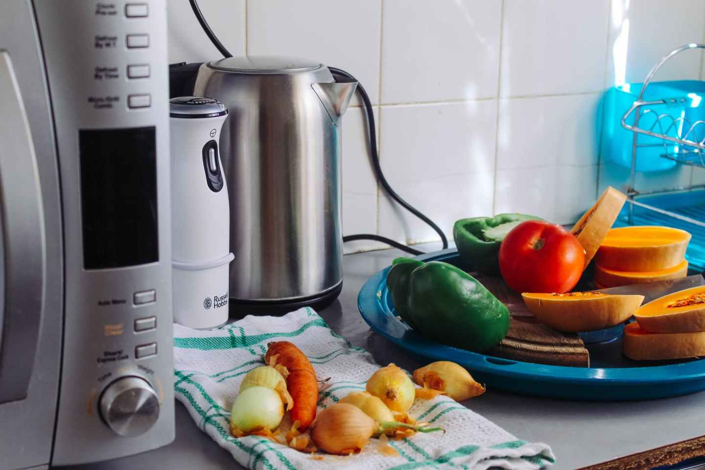 photo of vegetables beside gray electric kettle