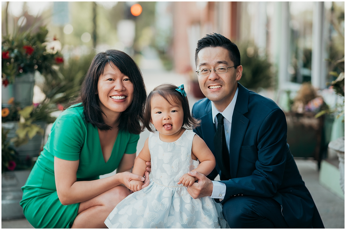 Family smiling at camera downtown photoshoot
