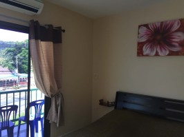 Simple room but with a balcony, great wifi and of course AC, and only $15 per night!