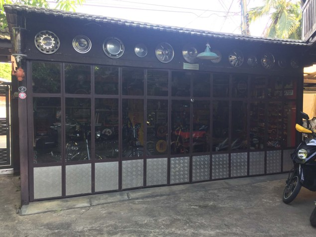 Motorcycle shed, full of old spotless Harleys and paraphernalia.