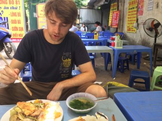 Enjoying another roadside restaurant. We order best when the menu has photos or we can just point at what we want, like we could here. For $2.50, it was a delicious, filling meal.
