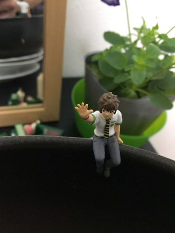 "One of the capsule toys. This is a fellow from the anime movie ""Your Name."""