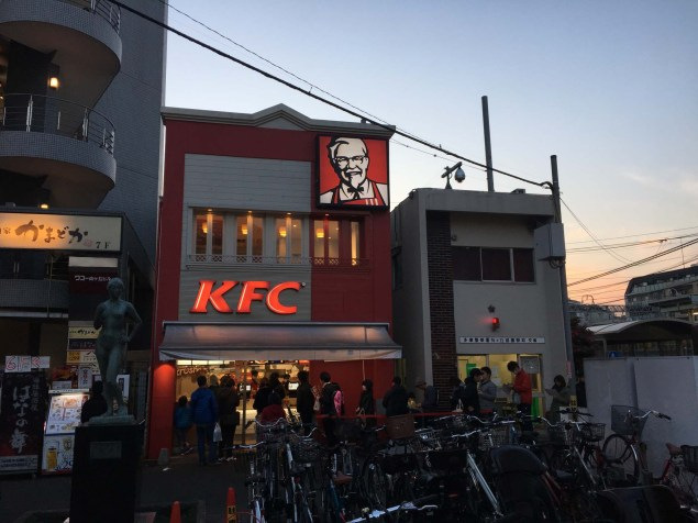 Lineup for KFC Christmas dinner pick-up in Kawasaki.