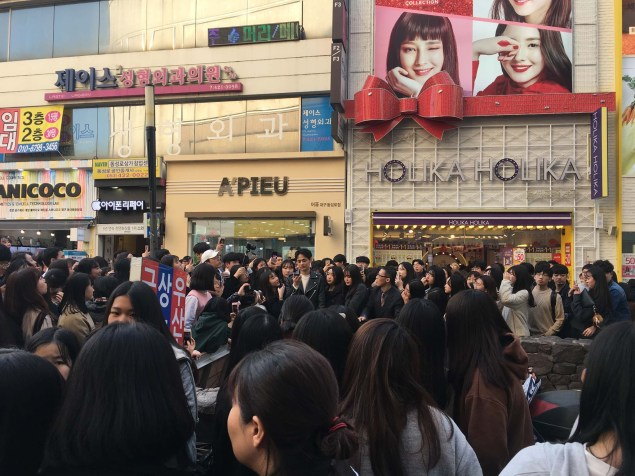 Perhaps a famous K-pop star. He was surrounded by adoring fans.