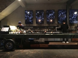 Warehouse turned cafe with drinks served off a truck bed. Thought I was in SF for a minute.