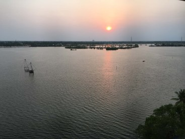 View over the backwaters from our deck. Chinese fishing nets are visible to the left.