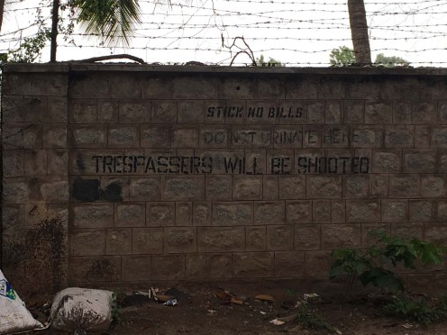 Warning sign around army camp.