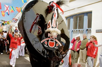 Hobby horses (or 'obby 'osses) dance through the streets of Padstow in Cornwall on May Day.