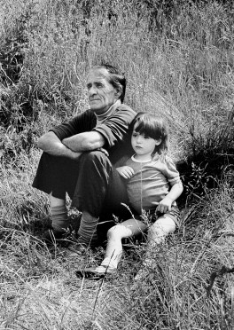 Young girl with her grandfather on sports day, Wales.