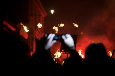 Hands taking a photo, Lewes Bonfire parade, Sussex