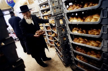 Selecting bread for the sabbath, Grodzinski's, Stamford Hill, London