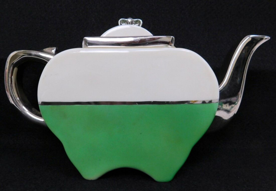 Green and white glaze with silver or platinum highlights.