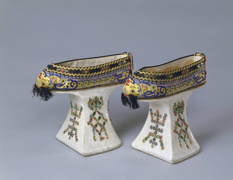 Platform shoes with tiger heads, the character for longevity, and bats. Guangxu period, 1875–1908.