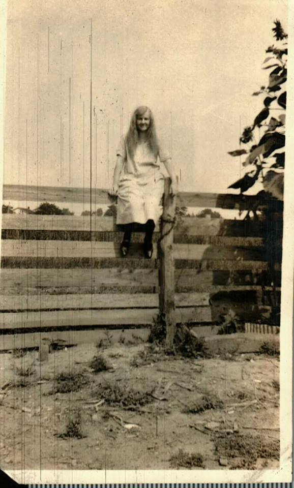 Girl sitting on a fence, Wentzville, Missouri. Undated.