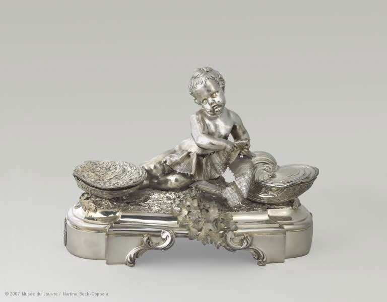 Salière. Child with oysters on either side that open up containing salt.