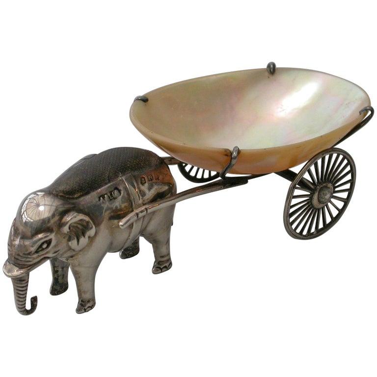 Elephant pincushion pulling a cart. 1910.