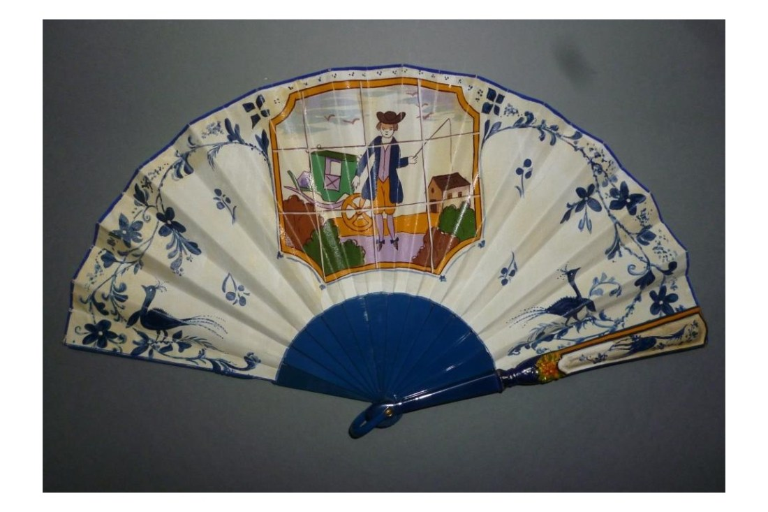 Hand fan with the paper-fabric leaf painted and the top of the guard made from wood.