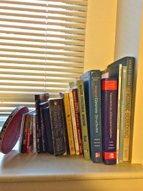 Her windowsill is packed with books she needs for class, and those that she reads for pleasure.