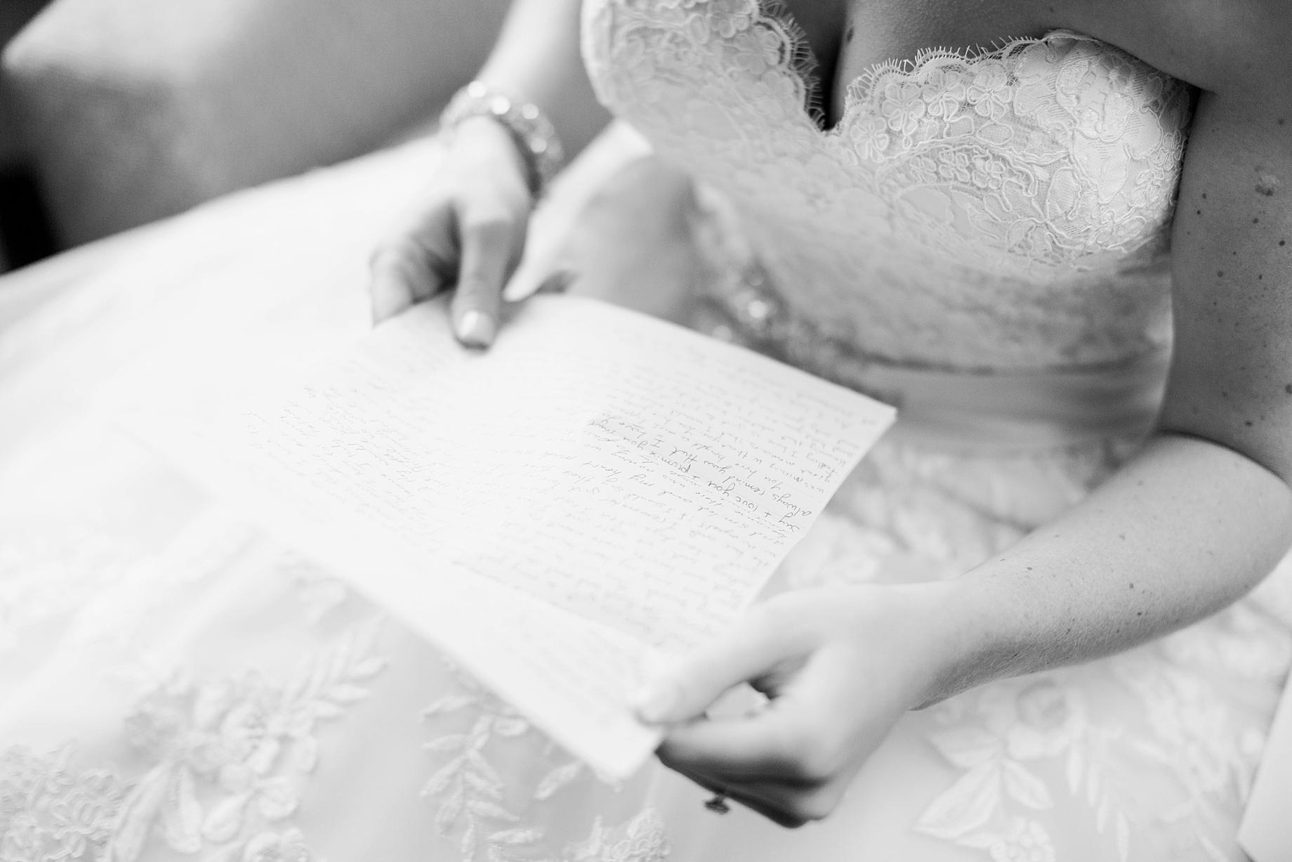 Bride reading a letter from the groom   William Penn Inn Wedding