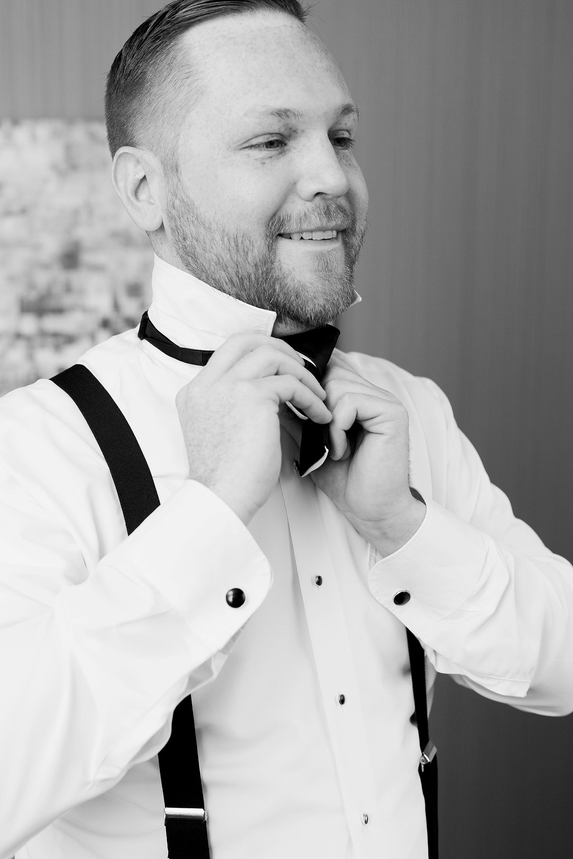 grooms tying his bow tie   William Penn Inn Wedding
