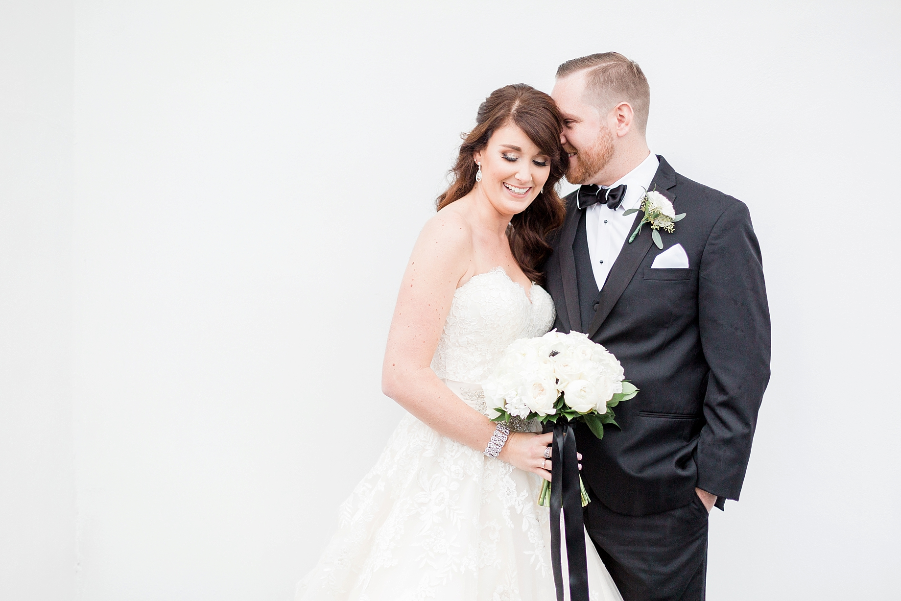 Bride and groom against white wall | William Penn Inn Wedding