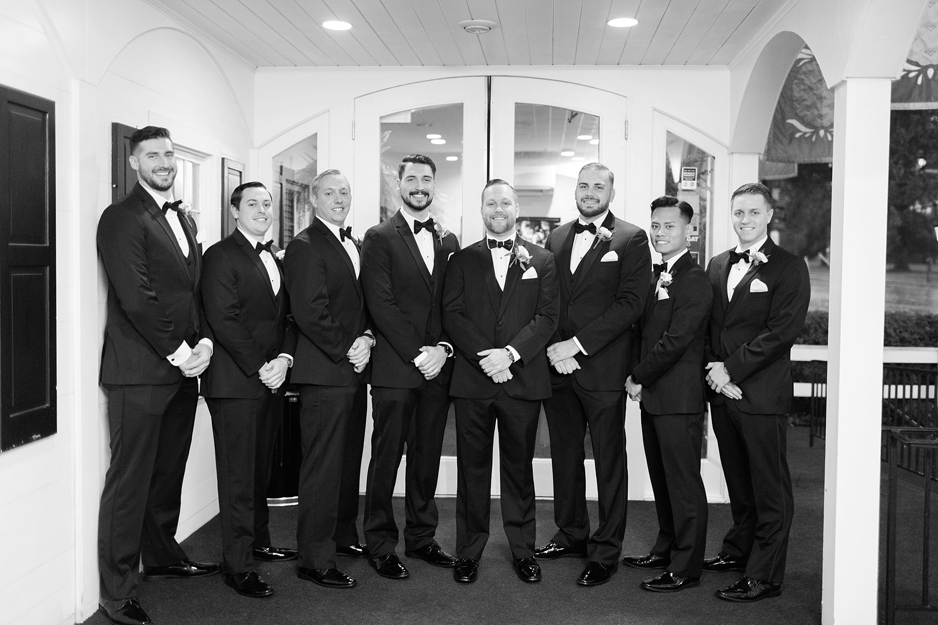 groomsmen in all black tuxes with bowties | William Penn Inn Wedding
