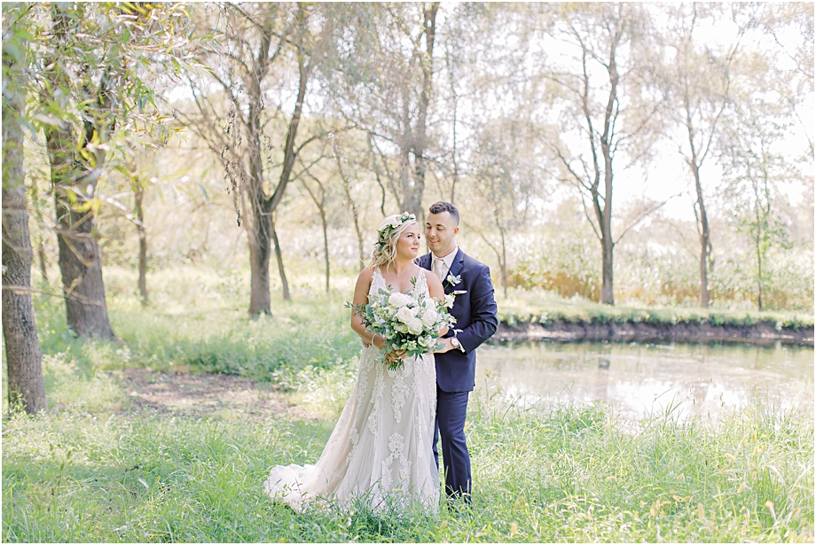bride and groom in field | bride and groom portraits | Hotel Du Village Wedding