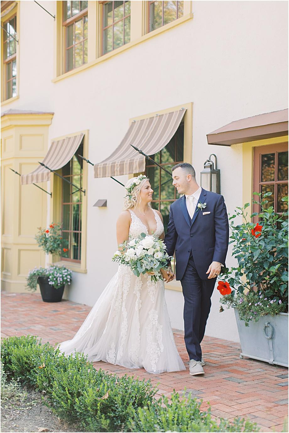 bride and groom walking at hotel du village wedding